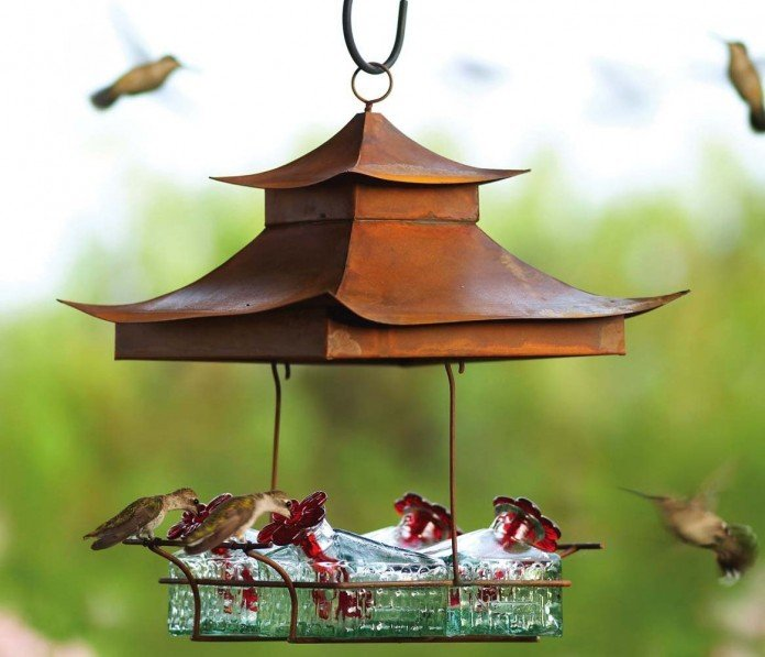 This Covered Feeder Has Four Square Glass Stations And A Pagoda Style Roof Very Zen Looking Many Hummingbird Feeders Use Red Flower S