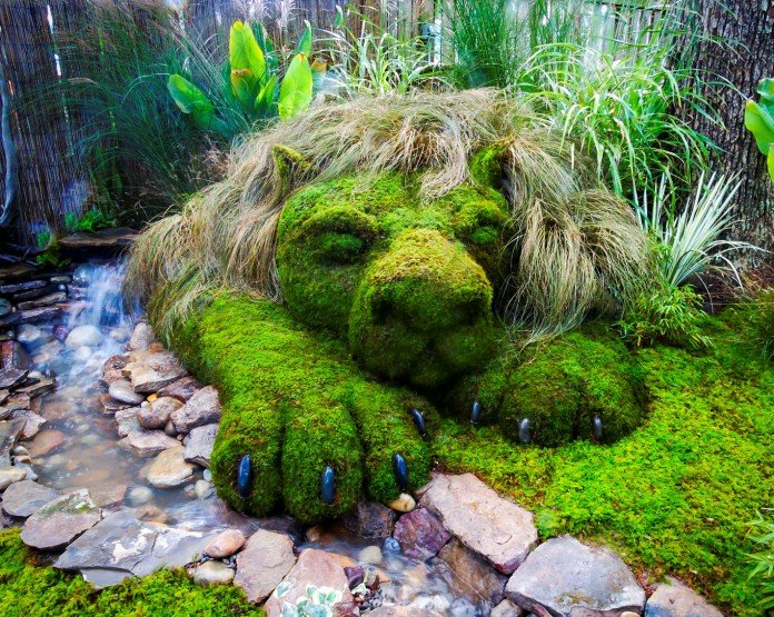 Moss and stone garden lion