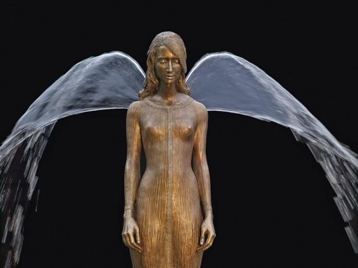 Malgorzata Chodakowska amazing garden water feature angel