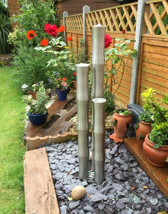 Steel bamboo pole water feature