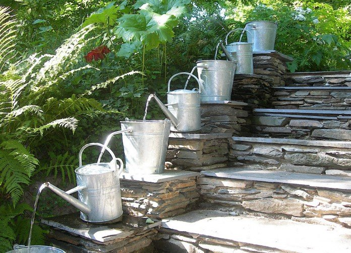 Watering Cans in the Garden are fountains