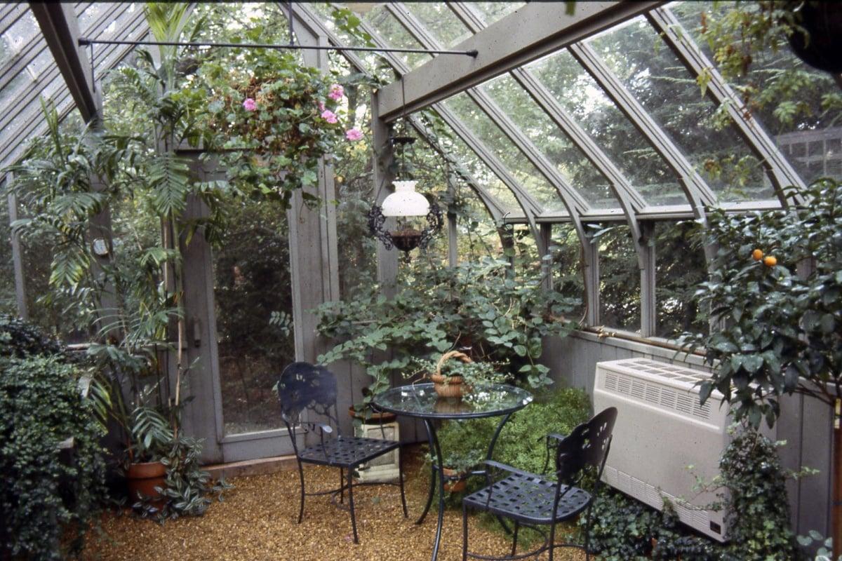sturdi-built-tudor-greenhouse-with-bistro-set