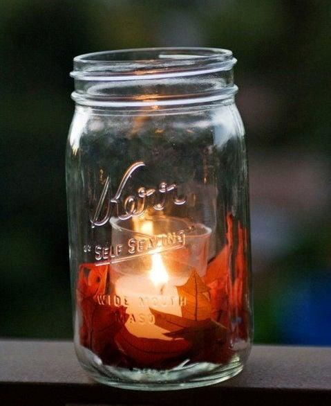 Mason jar candle with autumn leaves