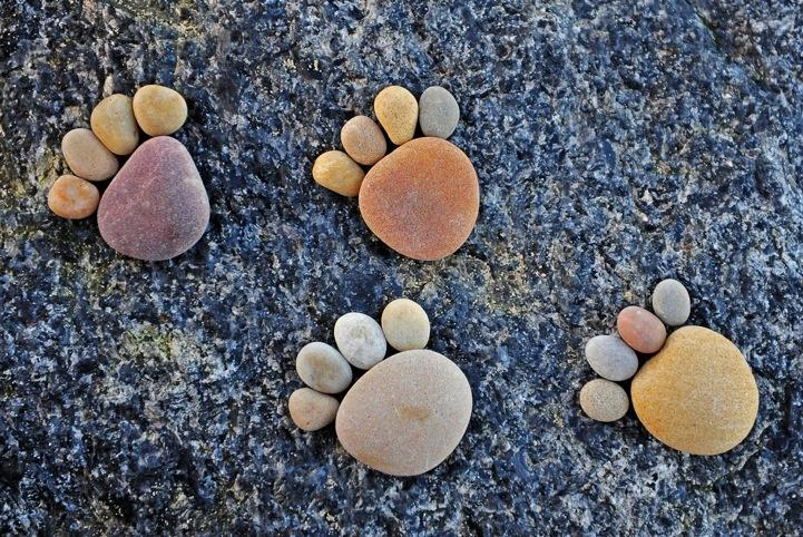 River rock footsteps by Iain Blake