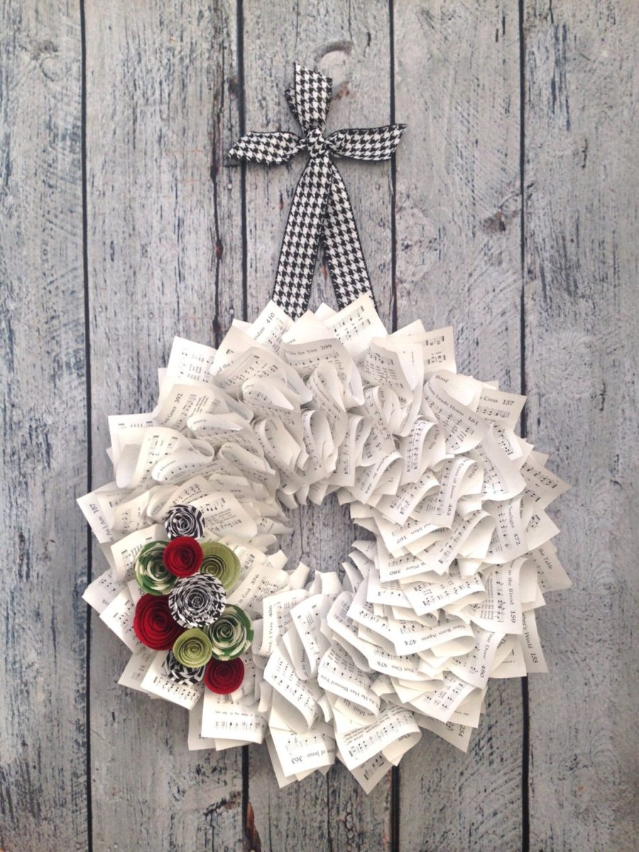 A Christmas wreath made from pages from hymnals
