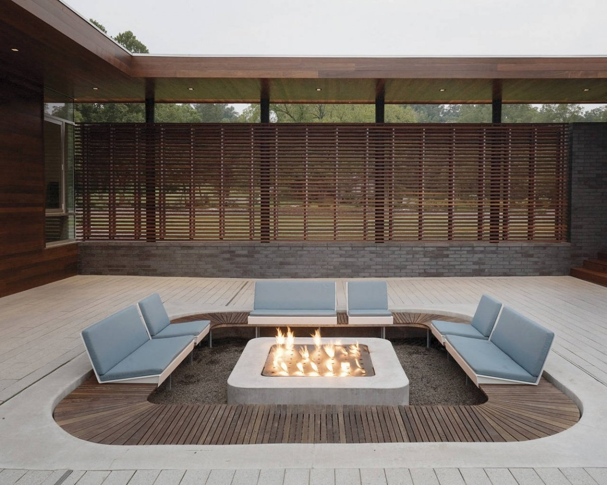 A rectangular sunken fire pit area
