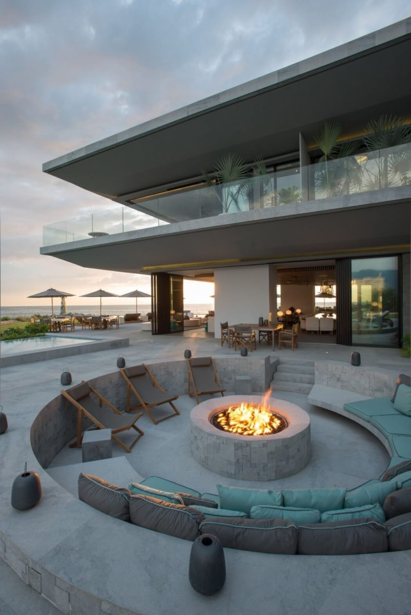 A circular sunken fire pit seating area