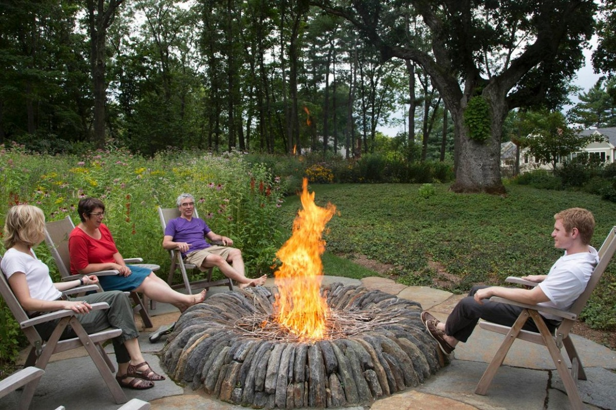 Scottish Masonry Fire Pit Design With Simple Foldable Wood Chairs