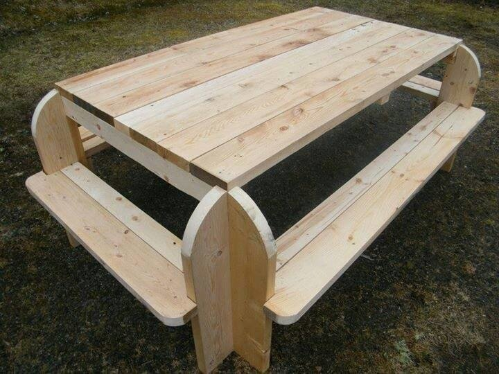 A DIY picnic table with benches on each side