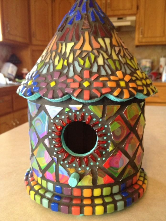 This cool mosaic birdhouse looks like they used chicklets