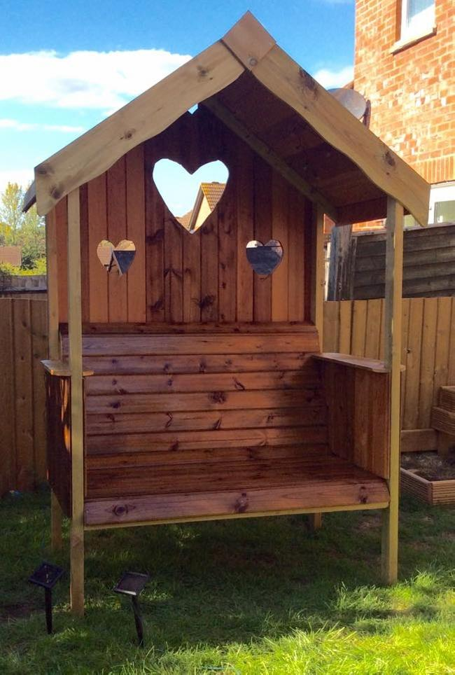 DIY pallet garden arbor bench with 3 carved hearts