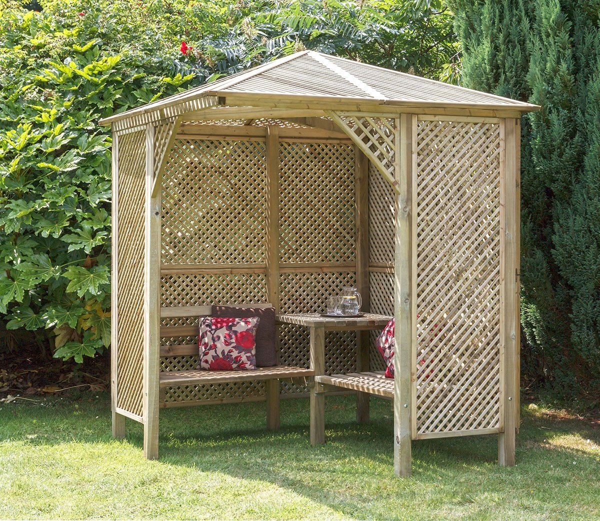 A very large gazebo style arbor with two benches and a table