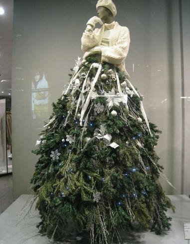 Mannequin tree dressed in white hat and gloves