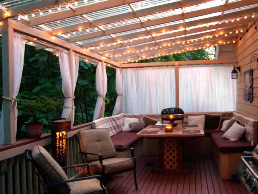 This covered deck with lights and drapes was featured on HGTV