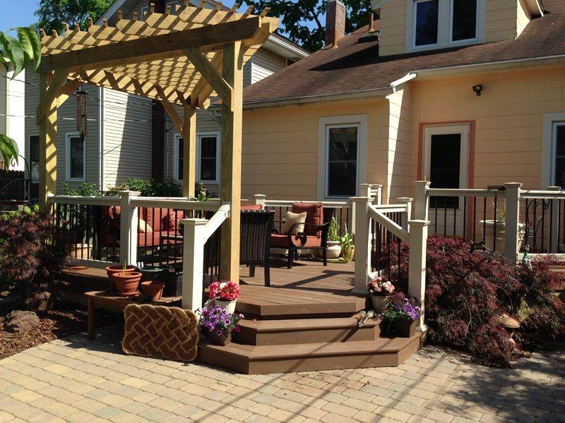 A nice deck partially covered with a triangular pergola