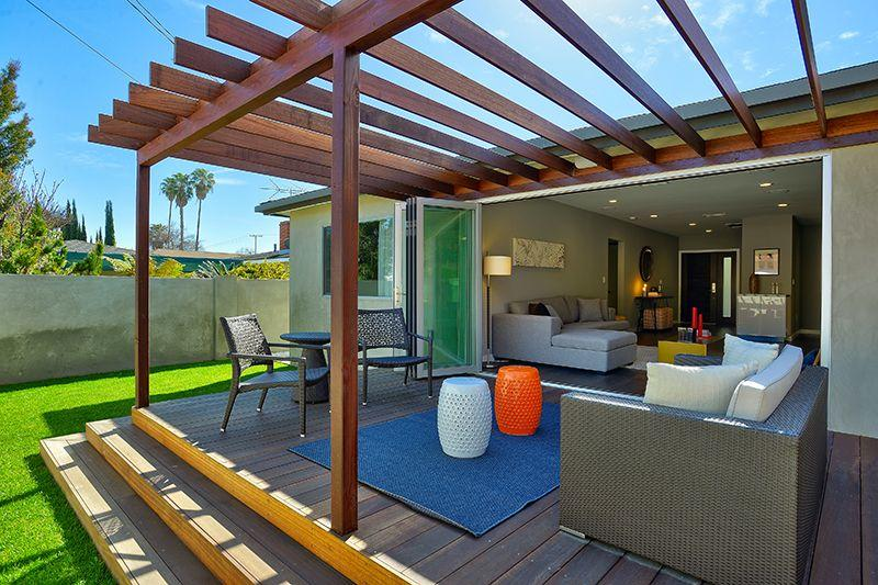 A modern covered deck with contemporary pergola