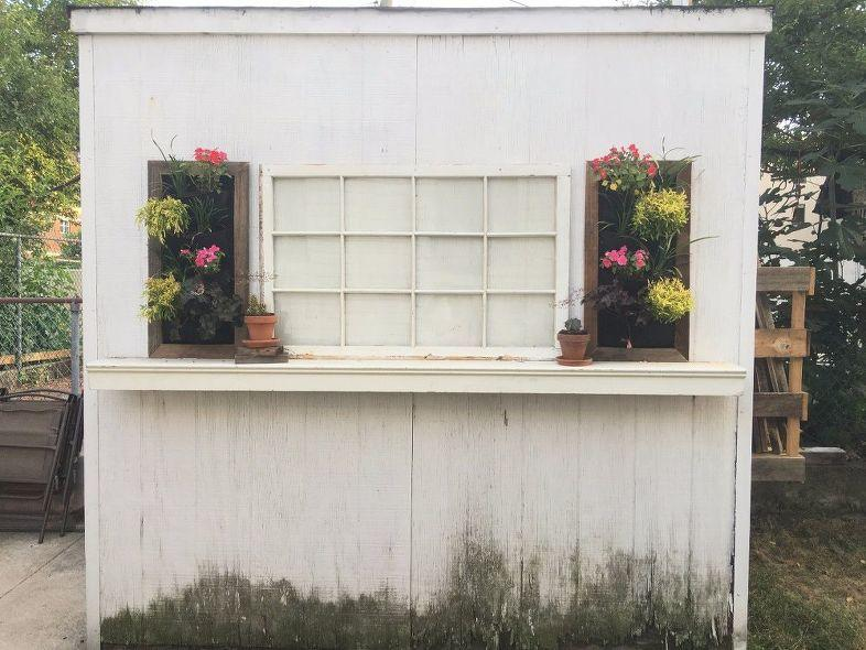 Old shed decorated with flower planters