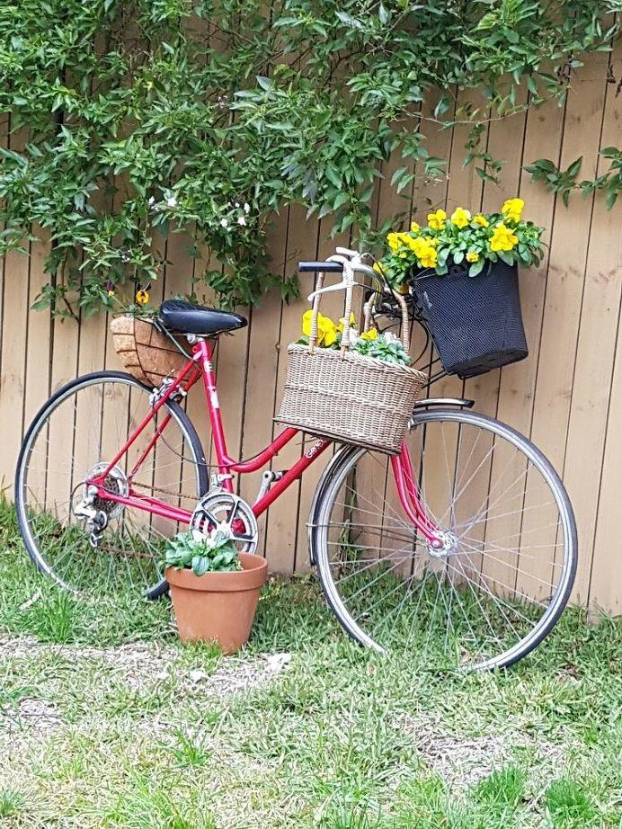 Red bicycle planter
