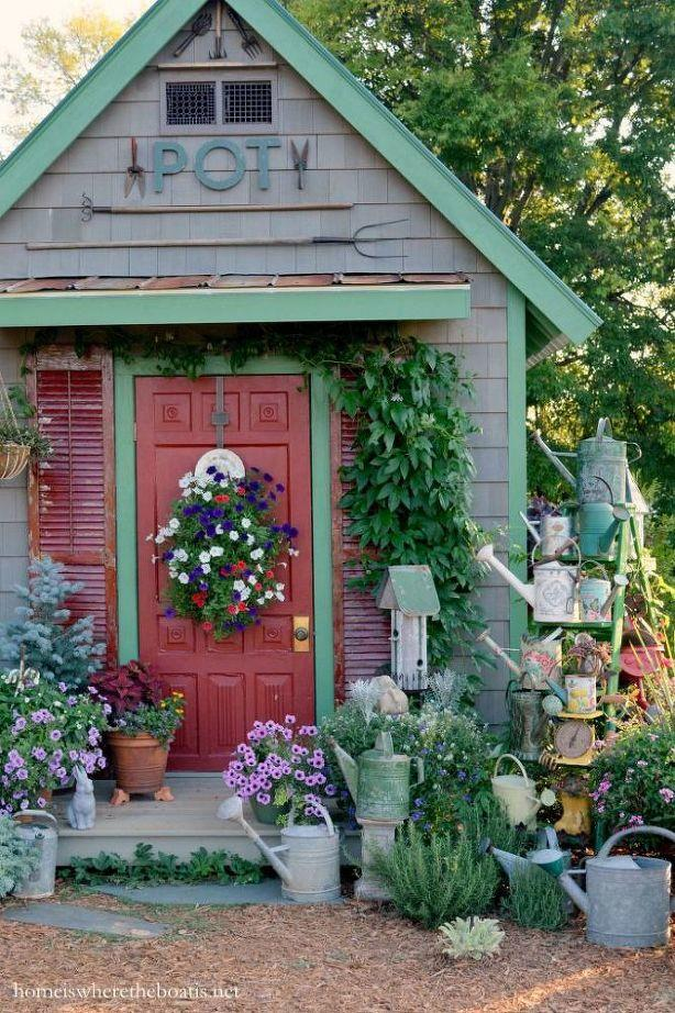 Watering cans as shed outdoor decor