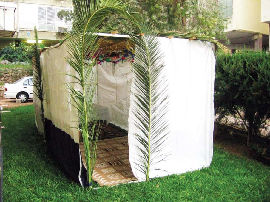 A sukkah build it with straws, sticks and bricks