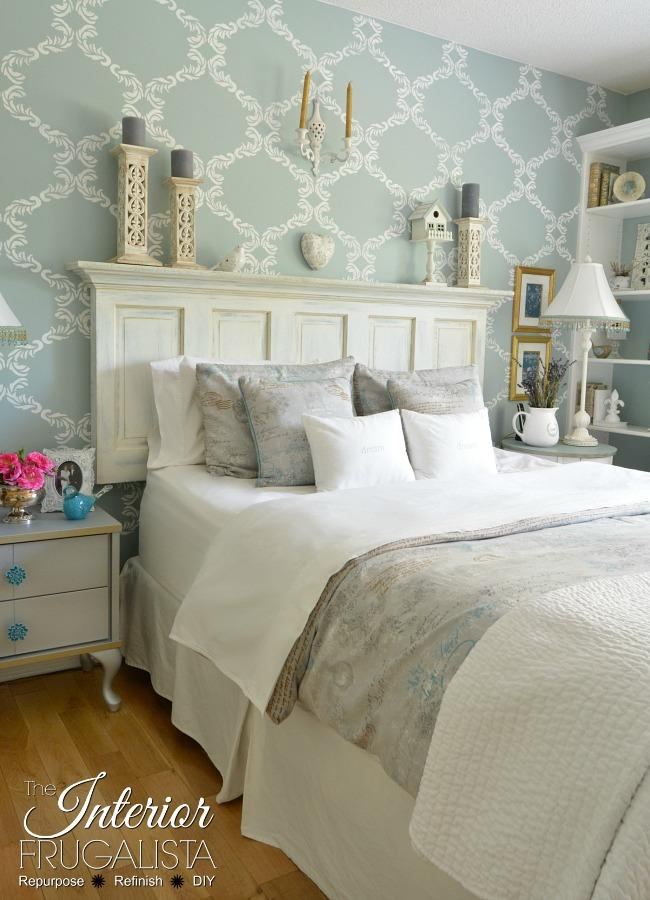 The white farmhouse style headboard looks great on wallpaper wall