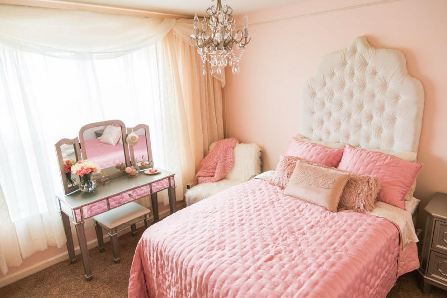 Pink bedroom with white headboard