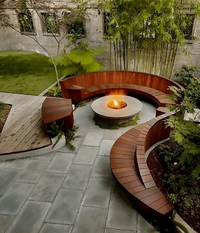 Amazing curved wooden fire pit seating design