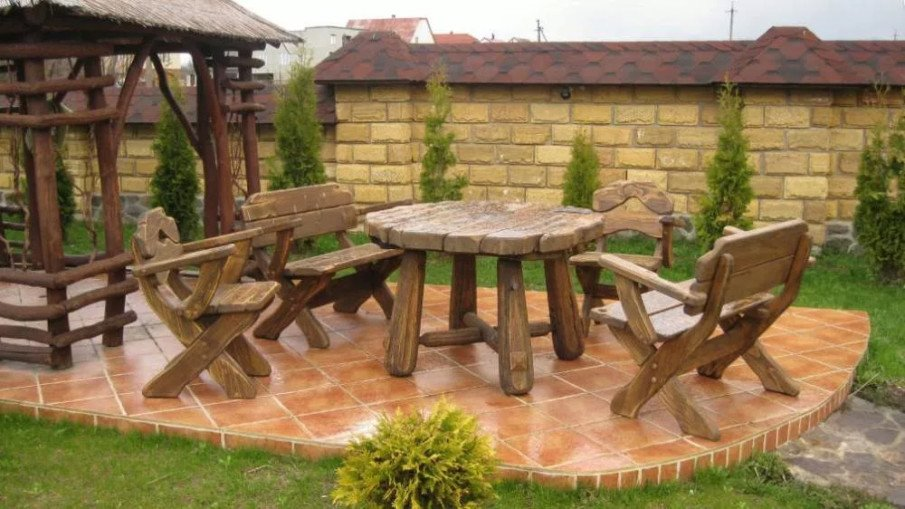 Artistic wooden table set for outdoors