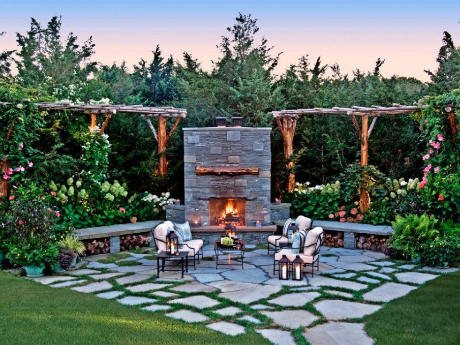 Awesome fireplace patio idea with grassy flagstone landscape