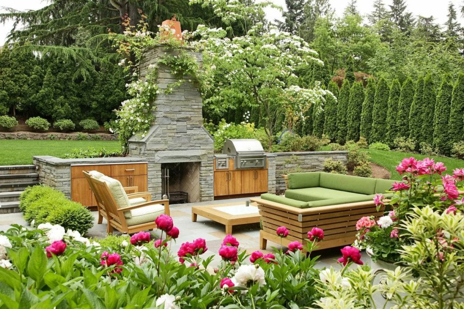 Awesome outdoor fireplace design with wood cabinets