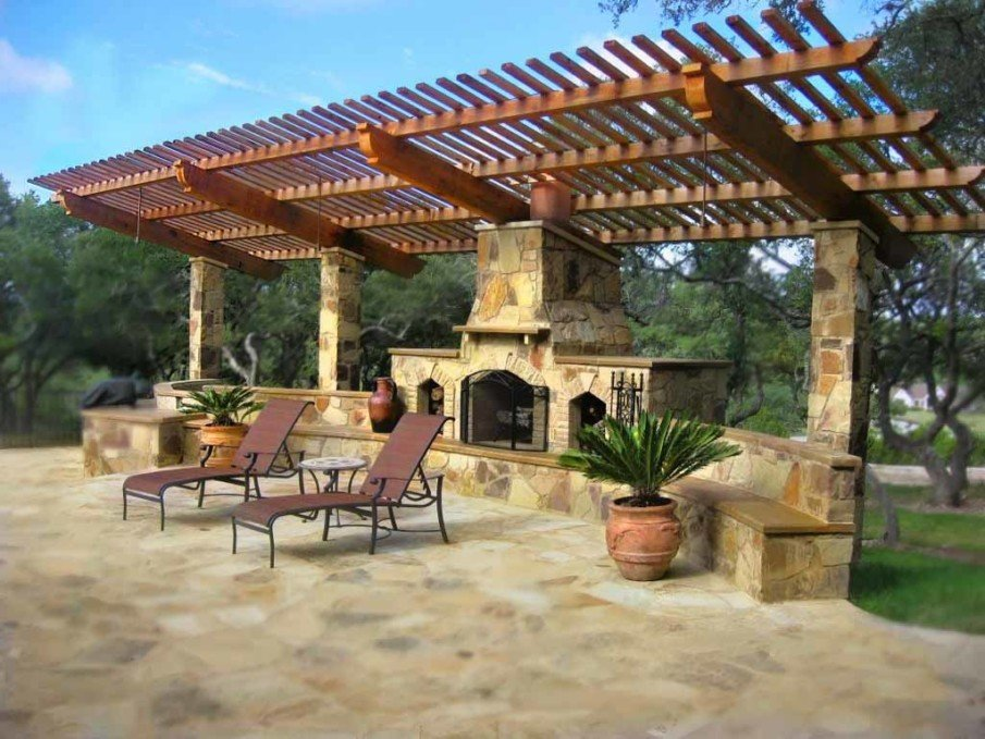 Backyard fireplace with pergola and patio seating