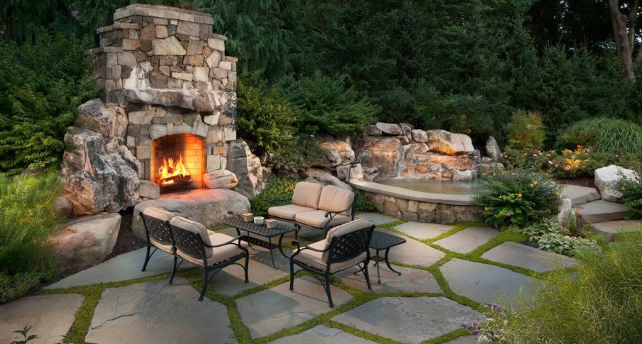 Beautiful rustic flagstone patio hardscape design with fireplace