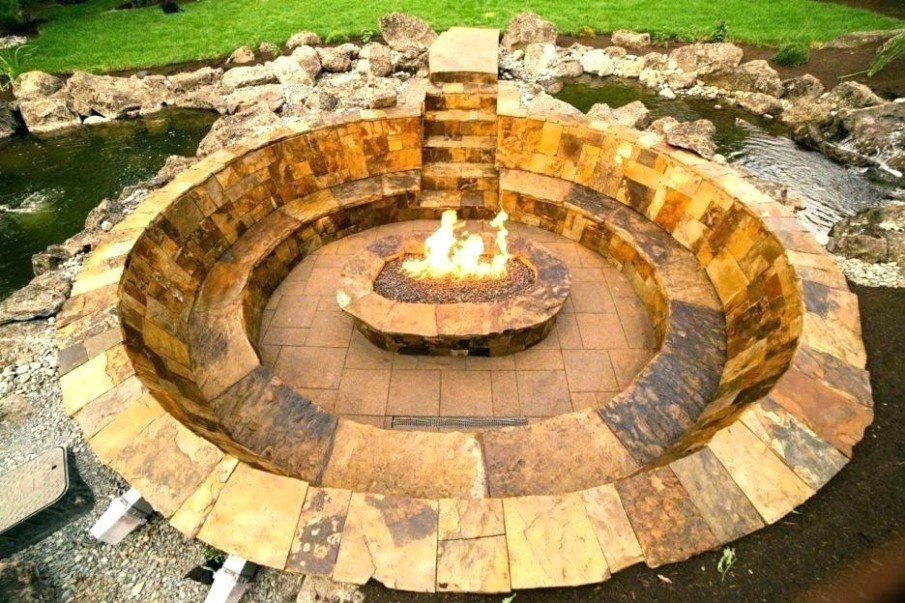 Beautiful sunken fire pit built into rock formation