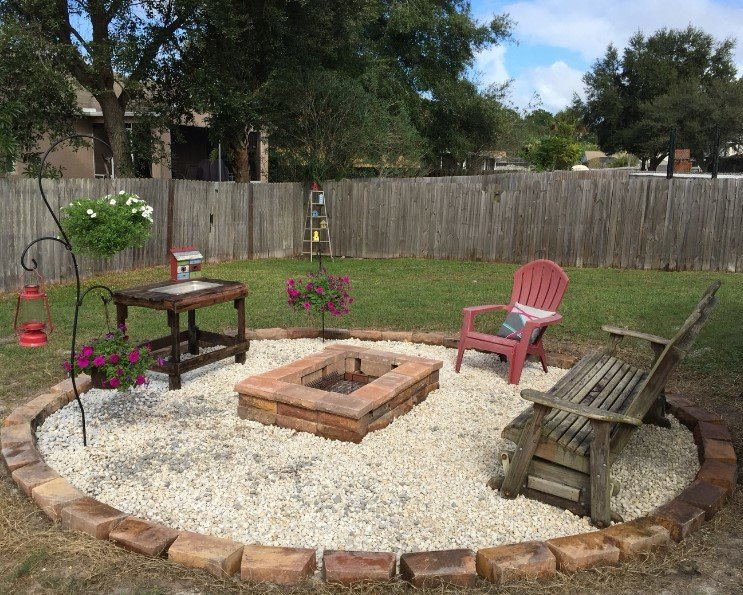 Rectangular fire pit in a circular gravel patio