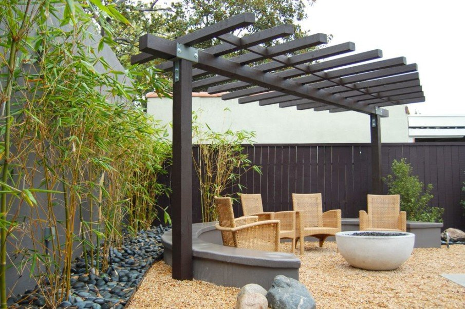 Cantilever pergola patio with an outdoor fireplace