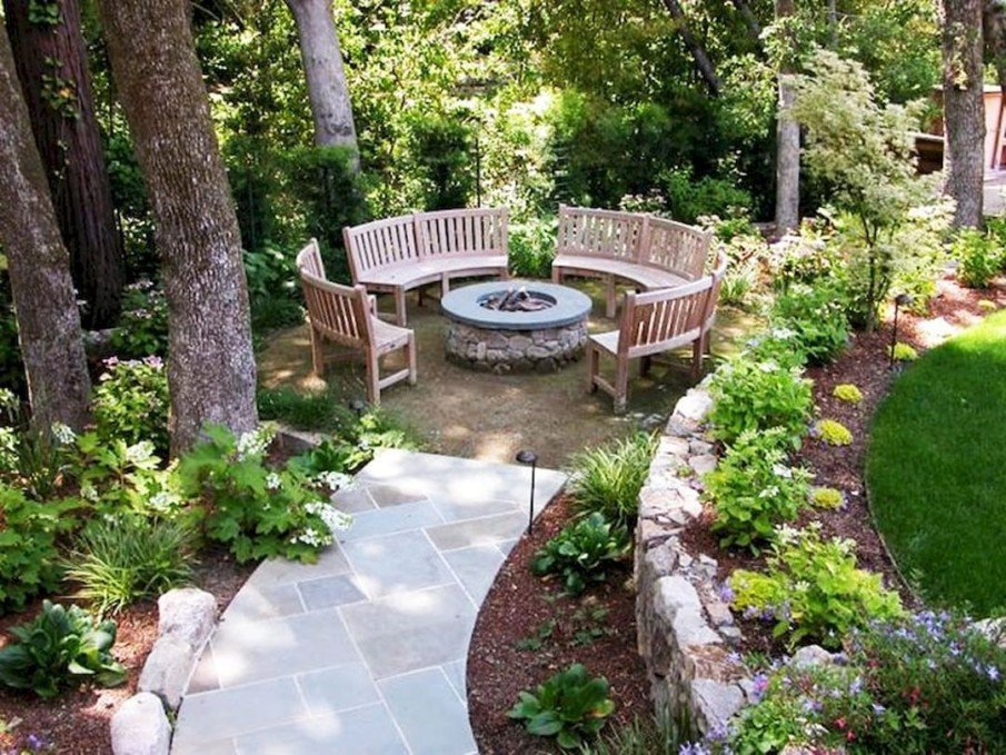 Circular benches create seating area around fire pit