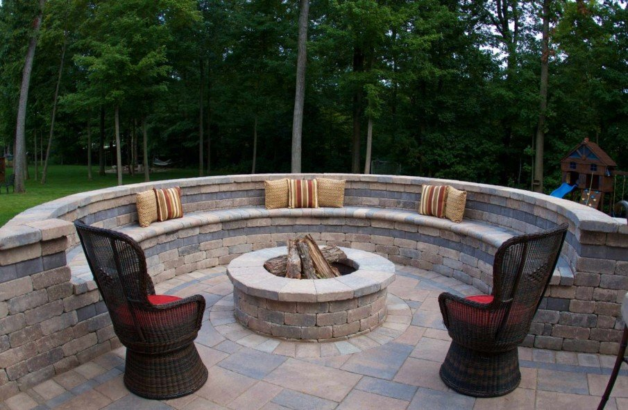 Circular brick fire pit seating area idea