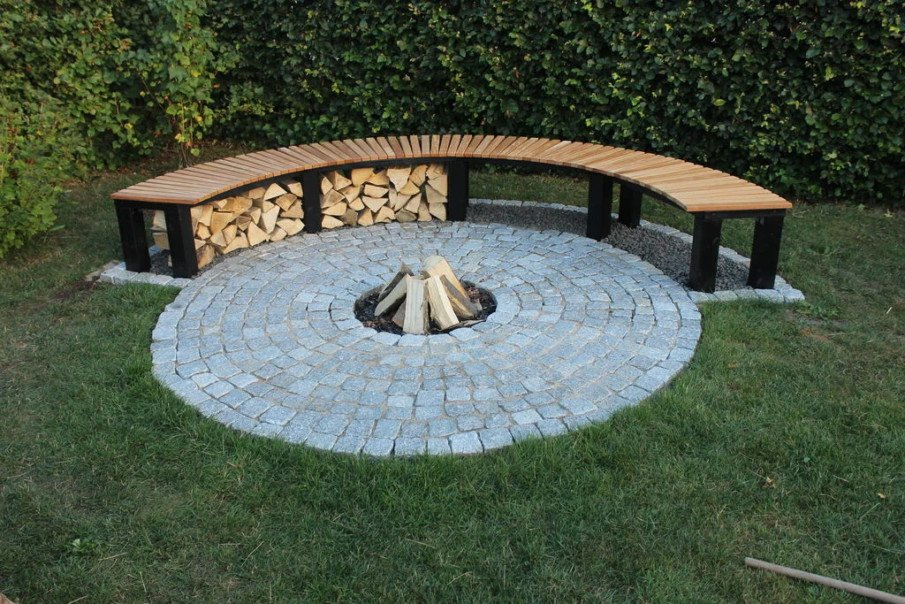 Circular fire pit seating with firewood storage idea