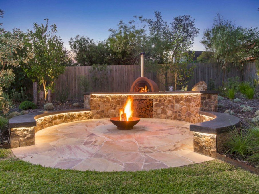 Circular patio seating with round metal fire pit
