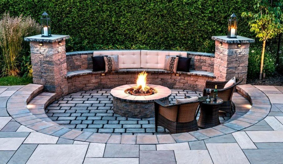 Circular sunken fire pit patio seating idea