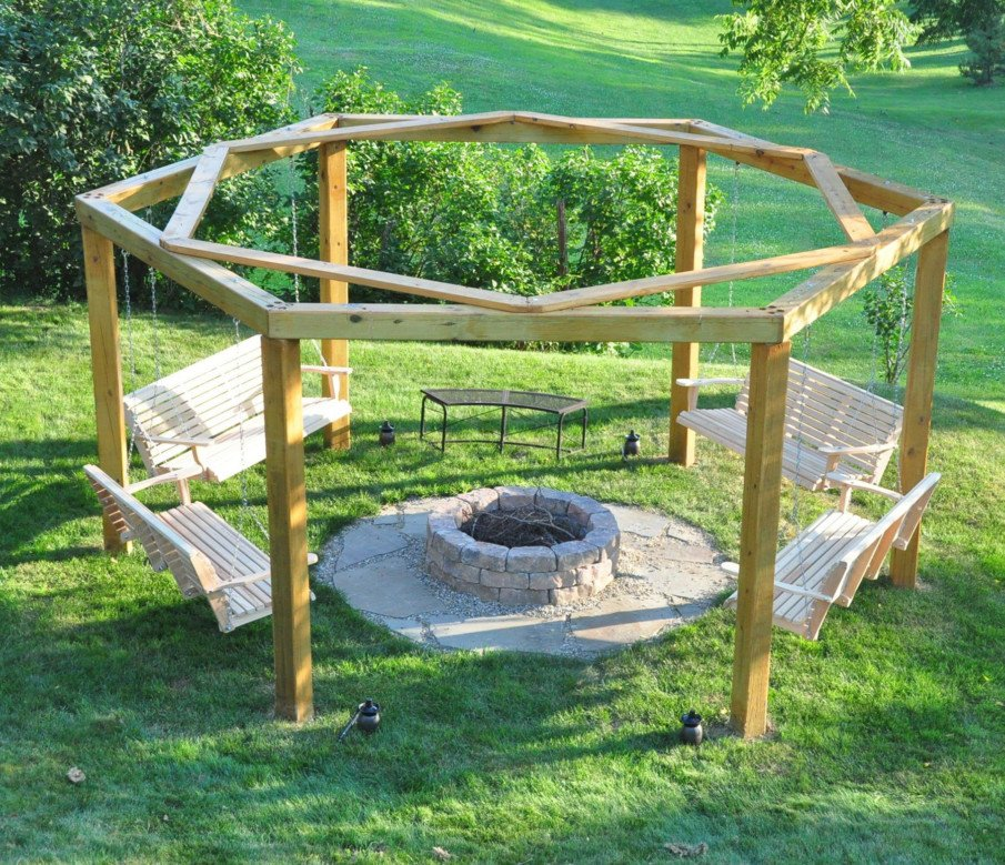 Circular swing pergola built around fire pit