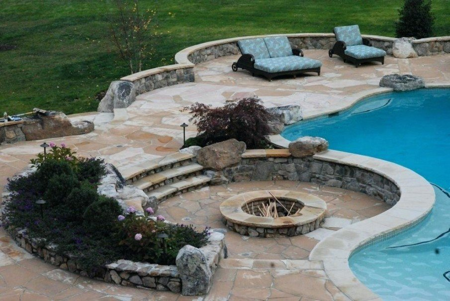 Classic sunken fire pit design by the pool