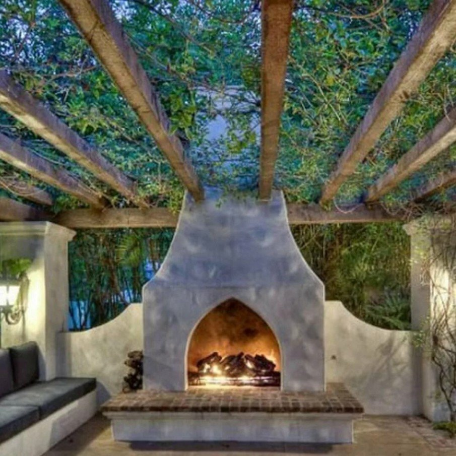 Climbing vines covering patio fireplace - a great idea