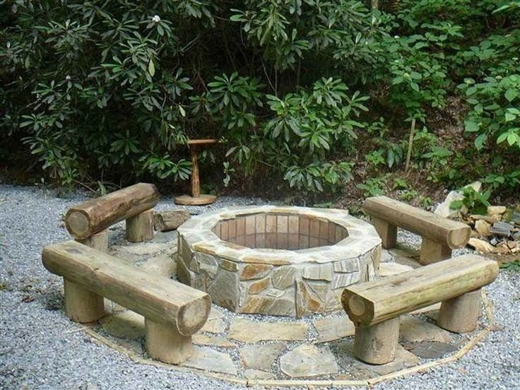 A budget backyard idea - log benches around a small patio with a fire pit