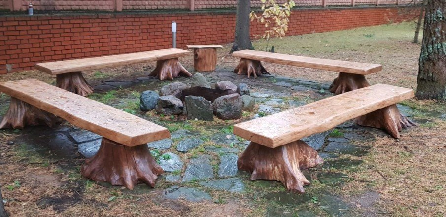 Rustic flagstone patio with fire pit and DIY wooden benches