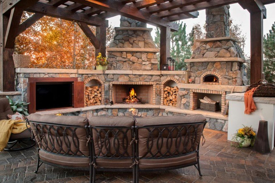 Semi covered patio with stone fireplace and TV