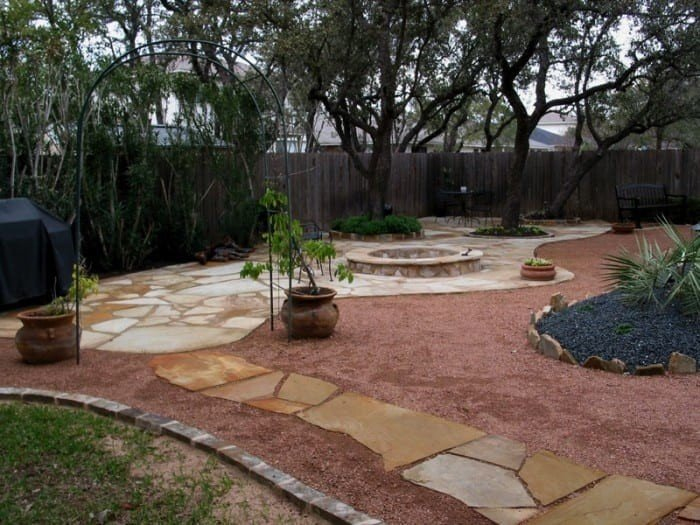 Curved flagstone patio design with fire pit