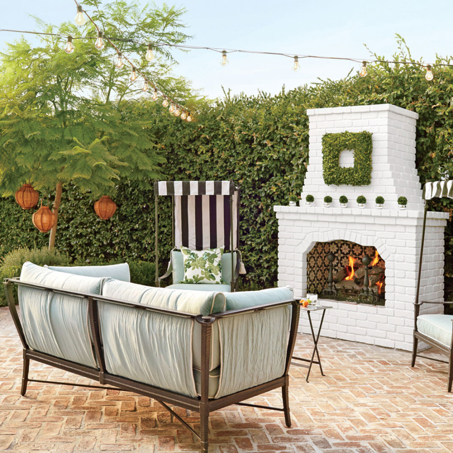 Cute brick fireplace idea for a patio