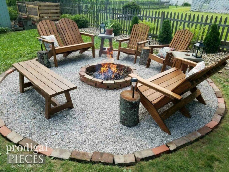 Brick and gravel fire pit with simple wooden patio furniture