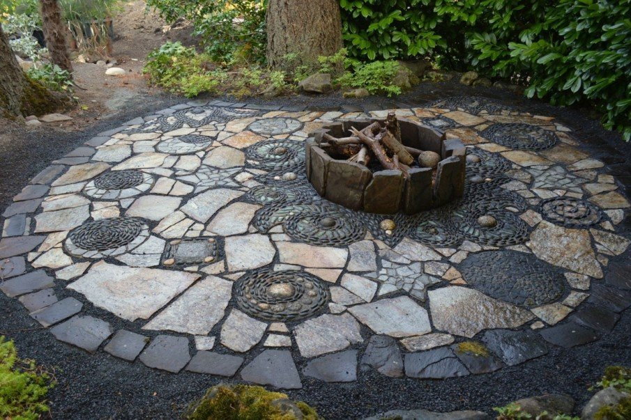 A fire pit flagstone patio with pebble mosaic